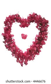 A photograph of flowers shaped as a heart.