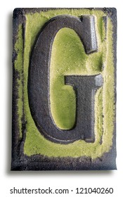 Photograph of Green Rubber Stamp Letter G