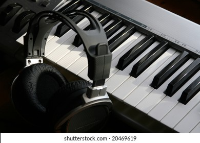 Photograph of headphones and electric piano.