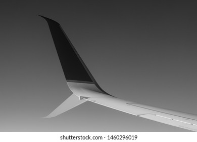 Photograph of jet wing out window.