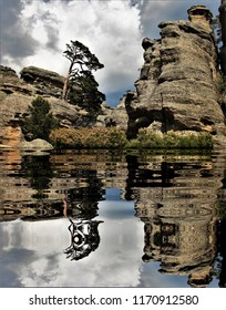 photograph of a karstic labyrinth reflected in the lake, located in natural park, Castroviejo, Duruelo de la Sierra, Soria, Spain