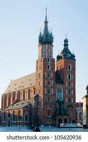 Photograph of main square in Krakow Poland. Krakow historical architecture: Mariacki church.