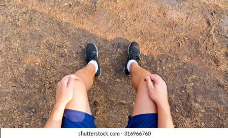 Photograph of male legs after run. First person point of view. Running/workout concept