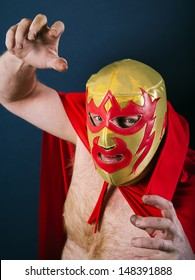 Photograph of a Mexican wrestler or Luchador standing in a fight pose.