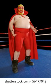 Photograph of a Mexican wrestler or Luchador standing in a wrestling ring.