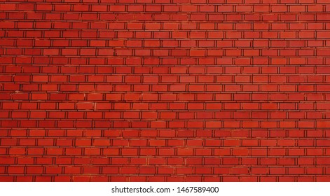 photograph of a neat red brick building wall