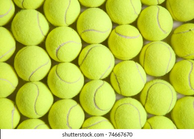 Photograph of numerous tennis balls from above.