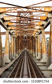 A photograph of a an old cantilever bridge taken from the railway track that it supports. This bridge is still operational as of today.