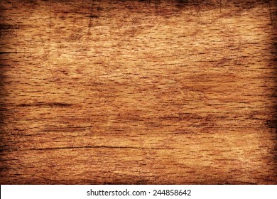 Photograph of old, roughly treated, warn out Beech Cutting Board vignette, grunge texture detail.