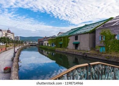 It is a photograph of Otaru canal in Otaru, Hokkaido of Japan. It is early morning in the summer.