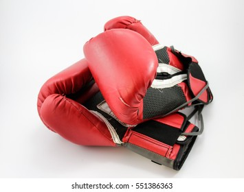 Photograph of a pair of red boxing gloves