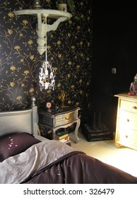 photograph of a part of a beautiful and romantic, well designed master bedroom