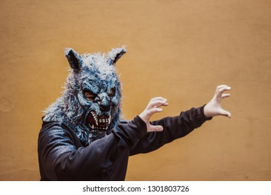 Photograph of a person with a wolf mask