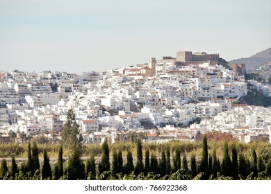 Photograph of popular architecture of Salobreña, tourist destination, white village of Granada, in the Mediterranean, typical constructions of the white villages of Andalusia, Spain,