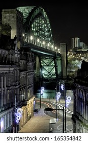 Photograph of the Quayside at Newcastle upon Tyne, England, with the famous Tyne Bridge placed prominently in the photo.