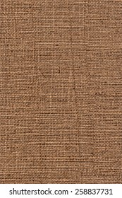 Photograph of raw, roughly woven, coarse grain, burlap grunge texture.