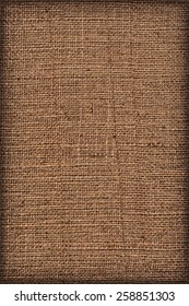 Photograph of raw, roughly woven, extra coarse grain, burlap vignette grunge texture.