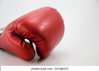 Photograph of a red boxing glove