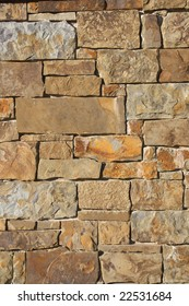 Photograph of a rock wall background.