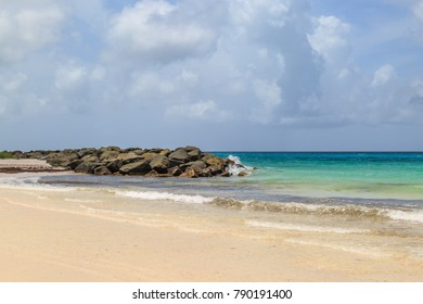 A photograph of rocks on a beach, on the caribbean island of Barbados
