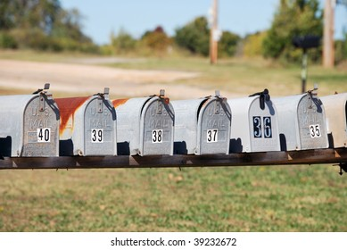 A photograph of a row of country mailboxes.