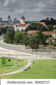 Photograph showing several well-known landmarks of Vilnius, including Gediminas Castle, Vilnius Cathedral, the Uzupis District, the Snipiskes financial district, and the Cathedral of the Theotokos.