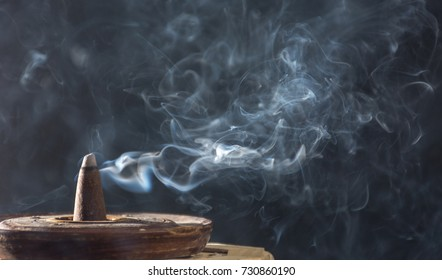 photograph of smoke caused by various incenses on black background