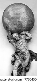 Photograph of a statue of Atlas holding globe.