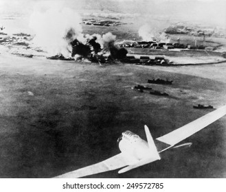 Photograph taken by a Japanese pilot, of the destruction of Pearl Harbor. At lower right is a Japanese bomber. Dec. 7, 1941.