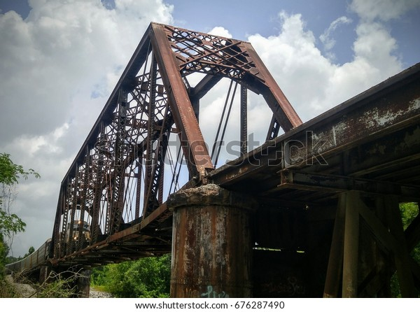 Photograph of Train on Railroad Bridge Over the Leaf River in Hattiesburg Mississippi on a Cloudy Day