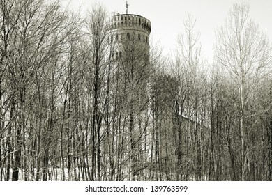 The photograph of two towers of the castle Granitz hidden behind trees and bushes/Castle Granitz