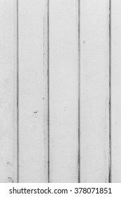 Photograph of a white wall made of wooden slats. Texture. Stock photography.