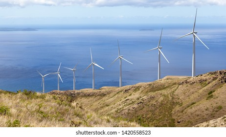 Photograph of wind turbines up on a mountain in Hawaii