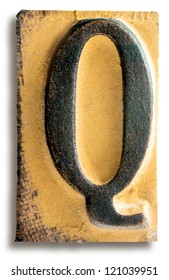 Photograph of Yellow Rubber Stamp Letter Q