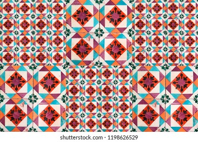 Photographe of traditional portuguese tiles in orange, turquoise and brown