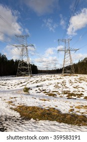 photographed close-up electric poles located in the field