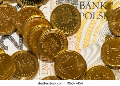 photographed close-up Polish money - coins and notes PLN , lying in a heap. Small depth of field