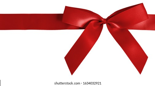 Photographed strip of red gift ribbon tied into a bow, cut out and isolated on a white background.