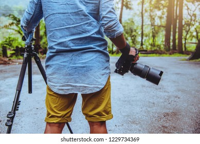Photographer asian man travel  nature. Travel relax. Nature Study. At public park in summer. National park doi inthanon in Thailand.
