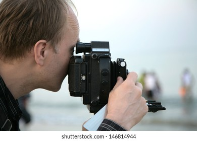 Photographer in beach, India