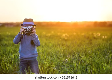 Photographer with camera outdoors