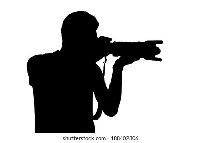 Photographer with camera. Side view silhouette of man holding digital camera while standing isolated on white