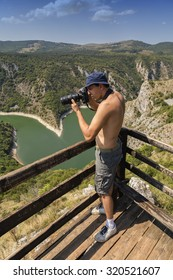 Photographer captures pictures of griffon vultures from the viewpoint Molitva. Photographer working in nature Reserve Uvac - Serbia. Made with selective focus and and shallow dof.