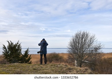 Photographer in a coastal landscape at the swedish island Oland