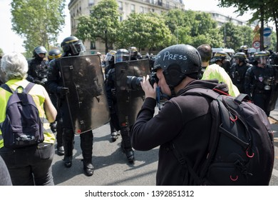 A photographer covers the events during the May Day protest in Paris, France. 01/05/19