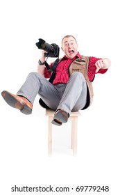 Photographer with digital camera and zoom lens on white background