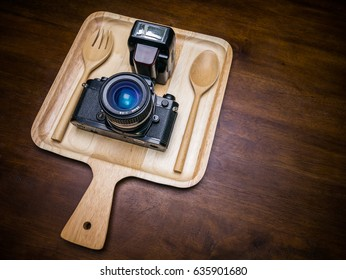 Photographer eat vintage camera with flash for food