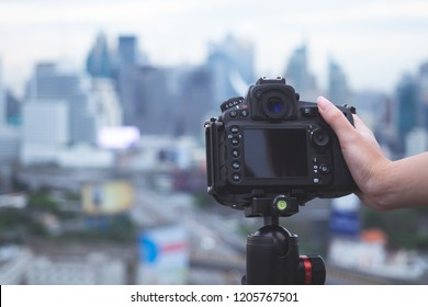 Photographer handling digital camera