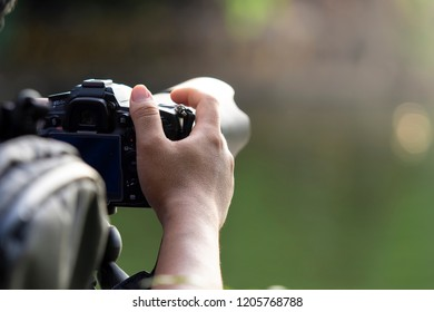 Photographer handling digital camera