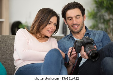 photographer and his wife man hold dslr camer